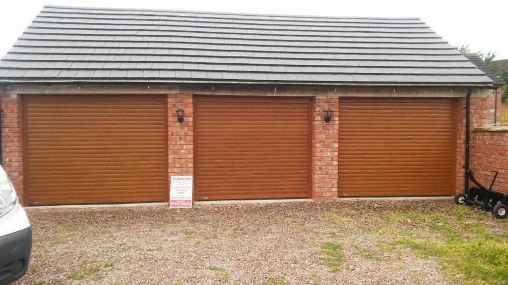 triple, wooden roller garage doors