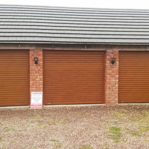 three oak roller shutter garage doors