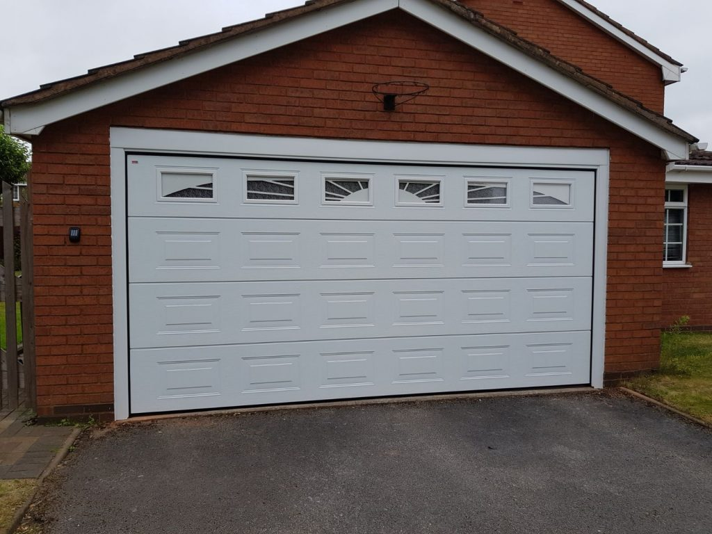 white cardale insulated electric sectional garage door