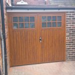 Installed side hinged wooden garage doors