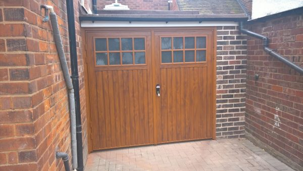 Installed side hinged wooden garage doors