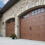 two wooden side hinged garage doors