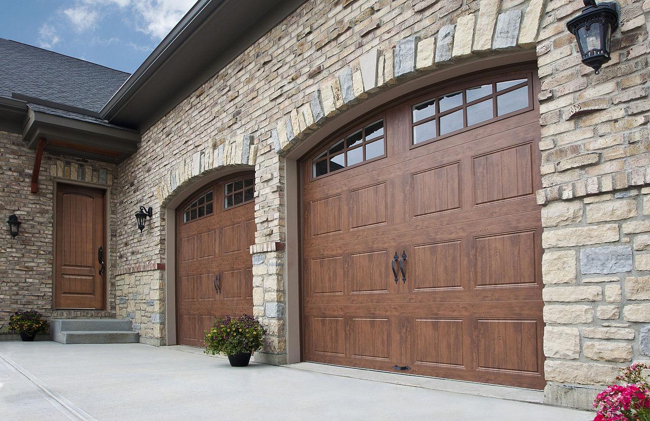 two wooden side hinged garage doors