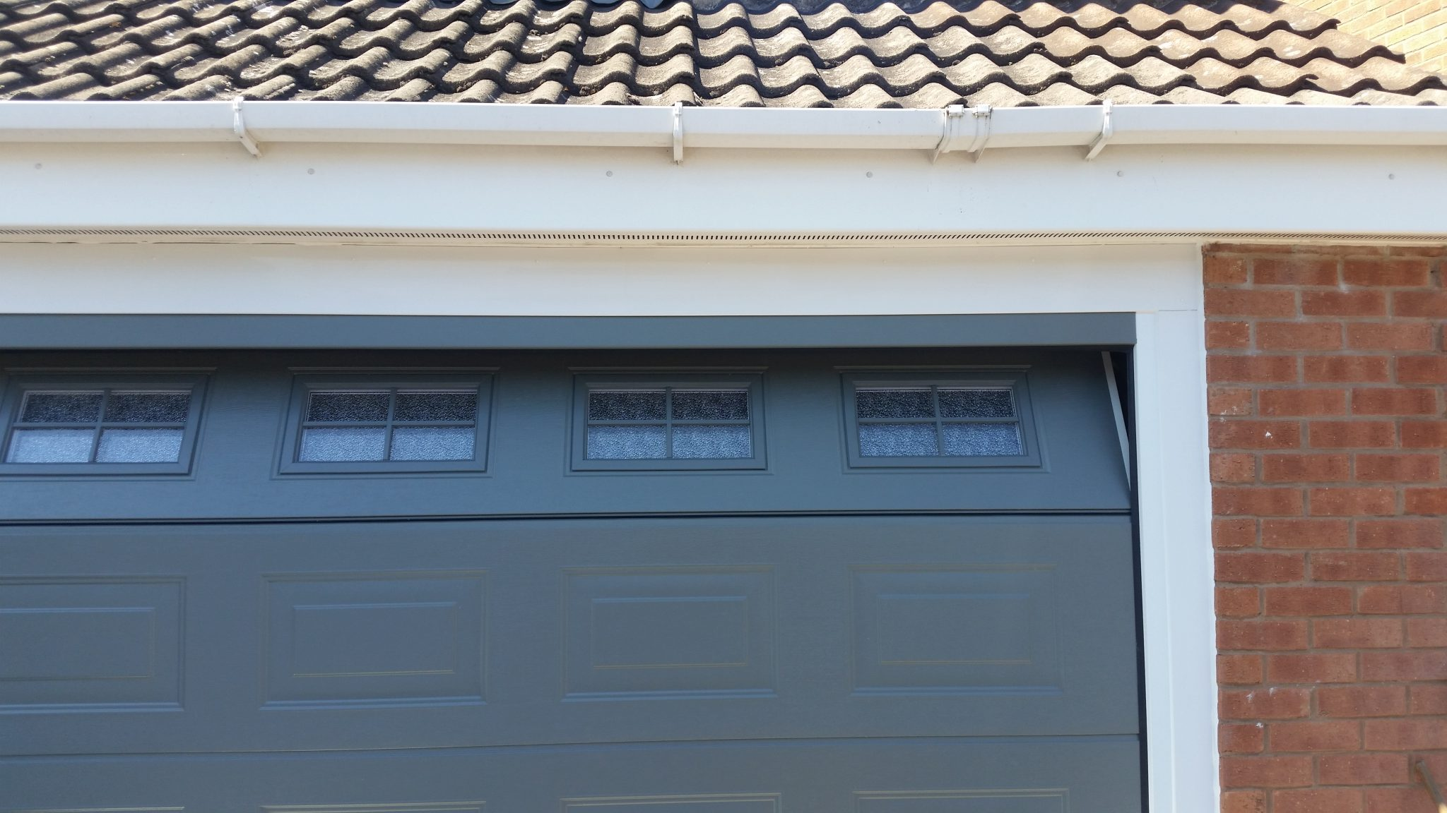 grey novoferm sectional garage door with windows