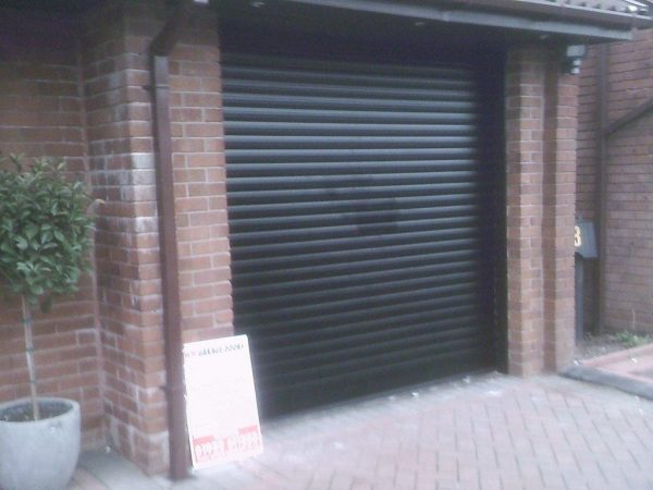 black automatic roller shutter garage door