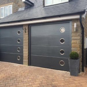 two black sectional garage doors with windows