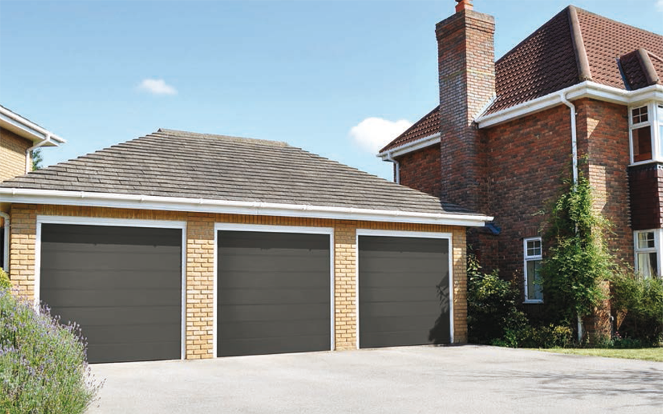 triple grey electric garage doors