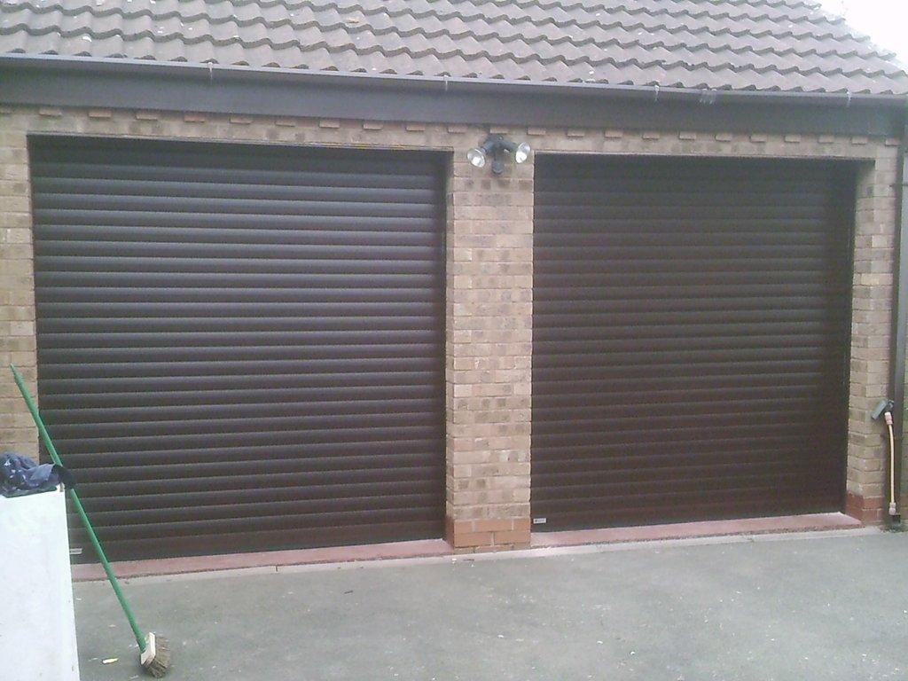 two black roller shutter garage doors