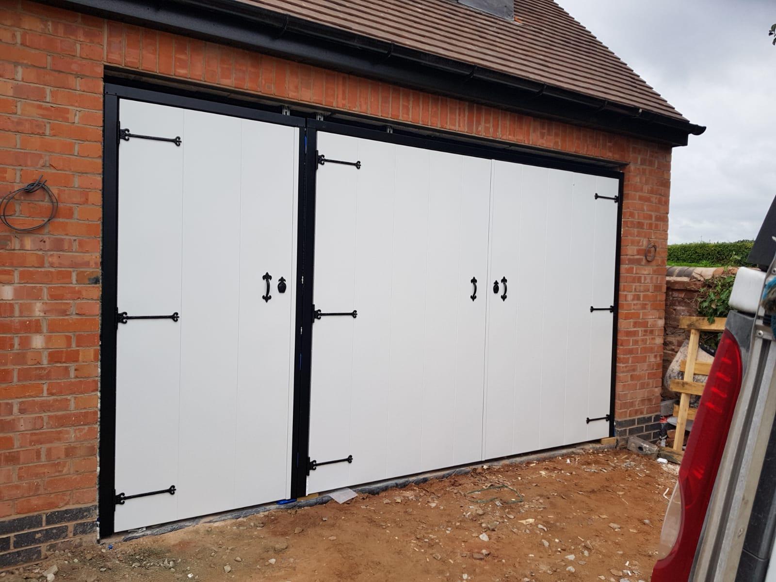 White side hinged garage door with pedestrian garage door access